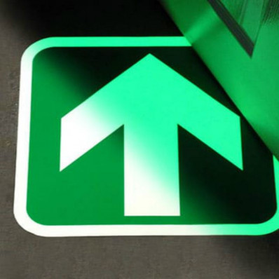 Phosphorescent adhesive arrow that glows in the dark for floors