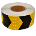 Nastro prismatico rifrangente giallo con frecce nere per segnalazione parcheggio