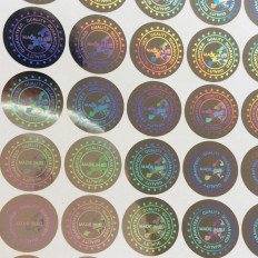 "64 holograms guarantee and safety 19mm seals written ""MADE IN"