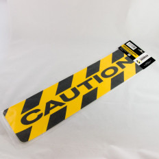 Autocollant antidérapant jaune et noir clouté avec inscription