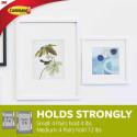 Strisce biadesive COMMAND™ by 3M per quadri e poster in 3 misure
