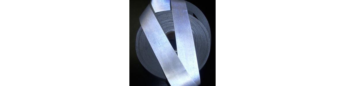 Faixa reflexiva na costura de tecidos